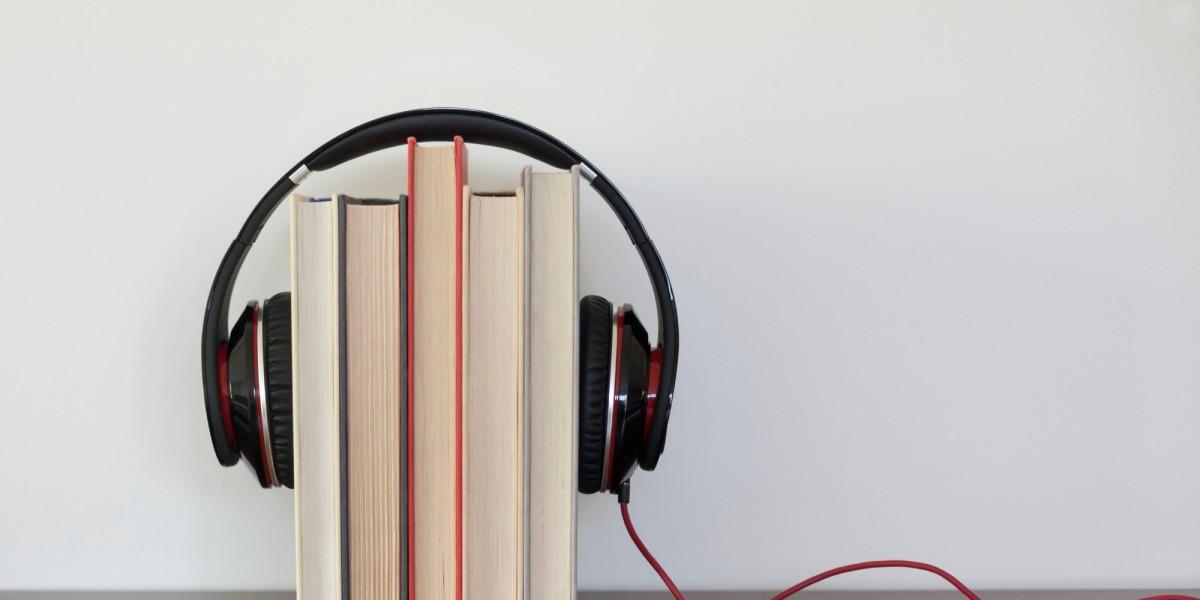 Headphones around a group of books
